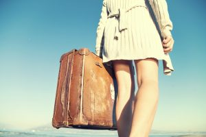adventurous woman traveling with her suitcase